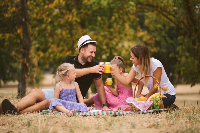 family drinking juice on camping